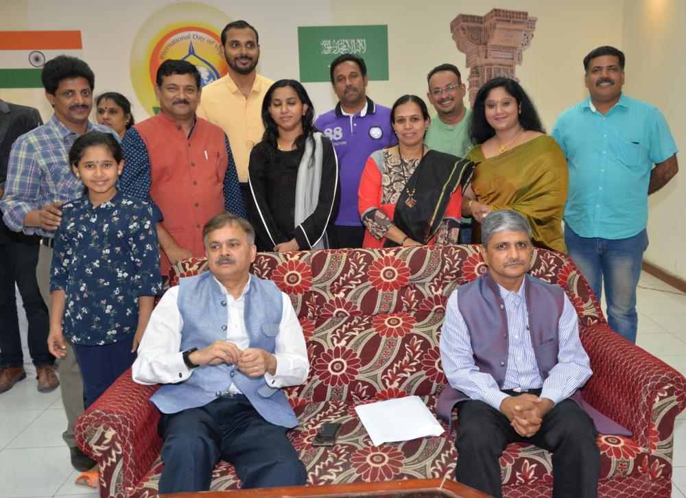 Indian Ambassador Ahmad Javed and Anil Nautiyal, counselor, Community Welfare, with some of the familes  at the meeting.
