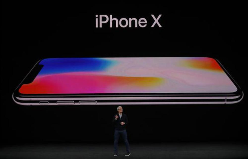 Apple CEO Tim Cook announces the new iPhone X during an Apple special event at the Steve Jobs Theatre on the Apple Park campus on September 12, 2017 in Cupertino, California. — AFP