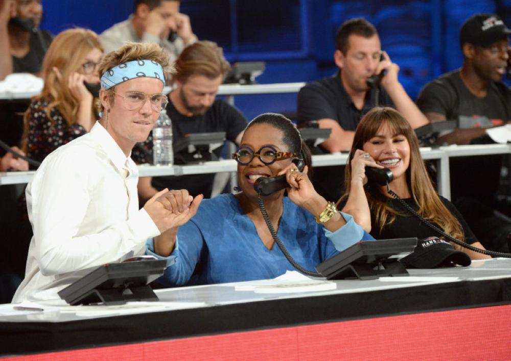 From left, Justin Bieber, Oprah Winfrey and Sofia Vergara attend
