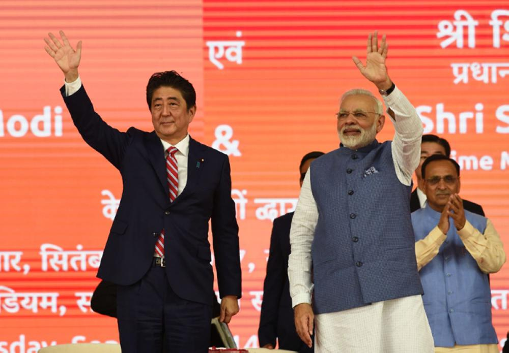 Japan PM Shinzo Abe in India, Modi welcomes him with bear hug
