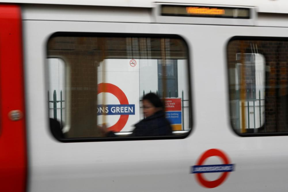 A passenger sits on an underground train leaving Parson's Green station after it reopened following an explosion on a rush hour train Friday morning, in London, Britain. Reuters