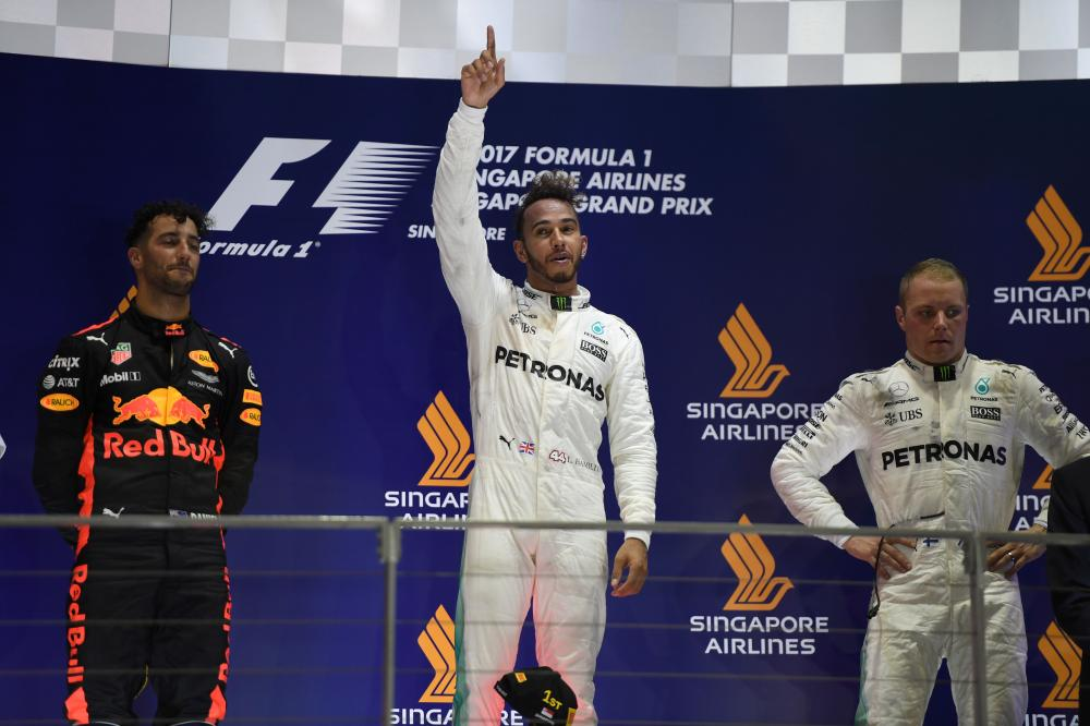 Formula One: Vettel out of Singapore GP as Hamilton leads