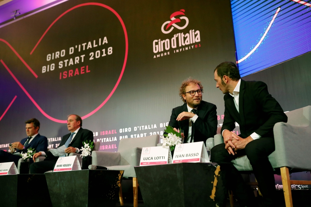 Italy's Sport Minister Luca Lotti (2R) talks to Italian cycling champion Ivan Basso during a press conference in Jerusalem on Monday, to give details of the opening stages of next year's Giro d'Italia which will be host in Jerusalem and Israel. — AFP
