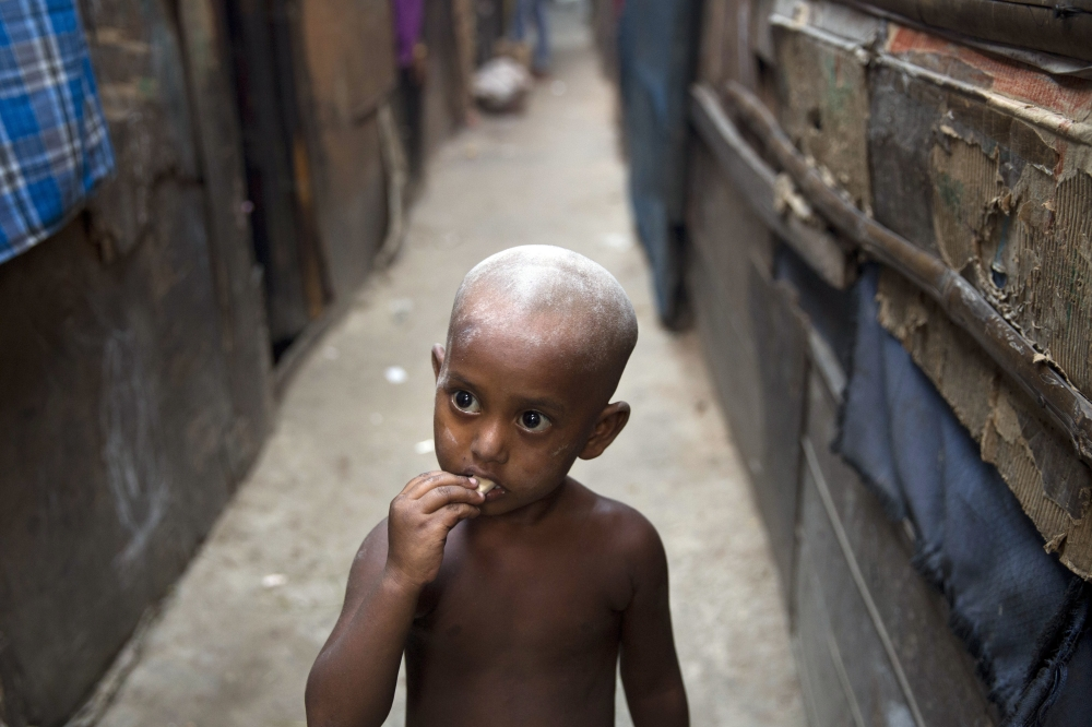 A Rohingya Muslim boy eats candy at a camp for refugees in New Delhi, India on Tuesday. - AP