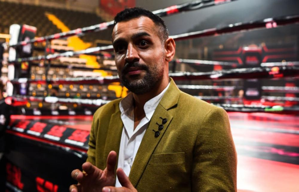 In this file photo, Bill Dosanjh, founder and CEO of Super Boxing League, gestures in New Delhi.  Boxing, badminton, poker, pool -- every sport imaginable is rebranding in India as a