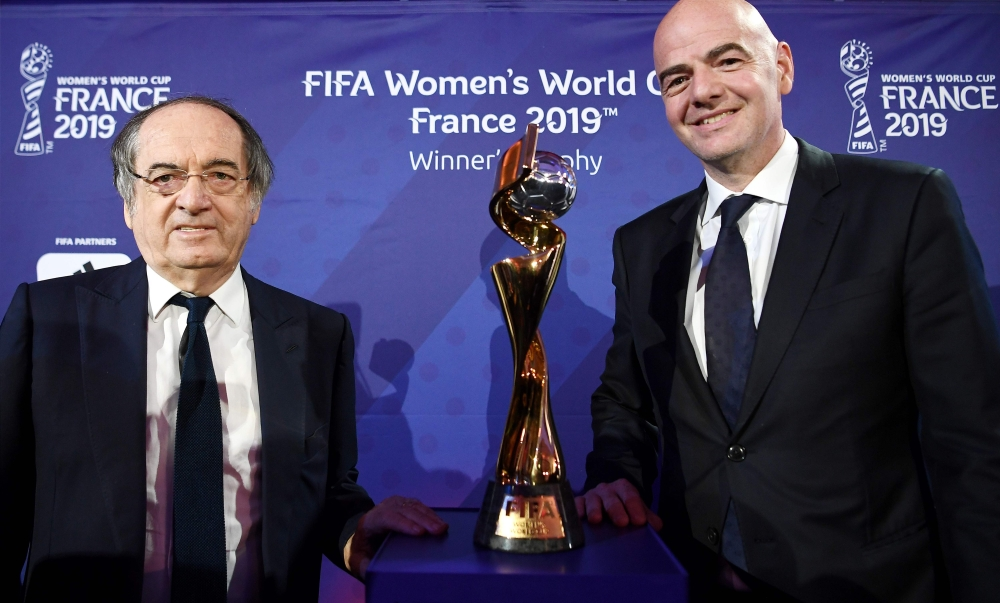 FIFA President Gianni Infantino (R) and French president of French football association (FFF) Noel Le Graet, pose next to the trophy after the official start of the organization of the 2019 FIFA Women World Cup in France on Tuesday in Paris.  The competition, which runs from June 7 to July 7, 2019, will see the opening game at the Parc des Princes in Paris, while the semifinals and the final will take place in Lyon.  — AFP