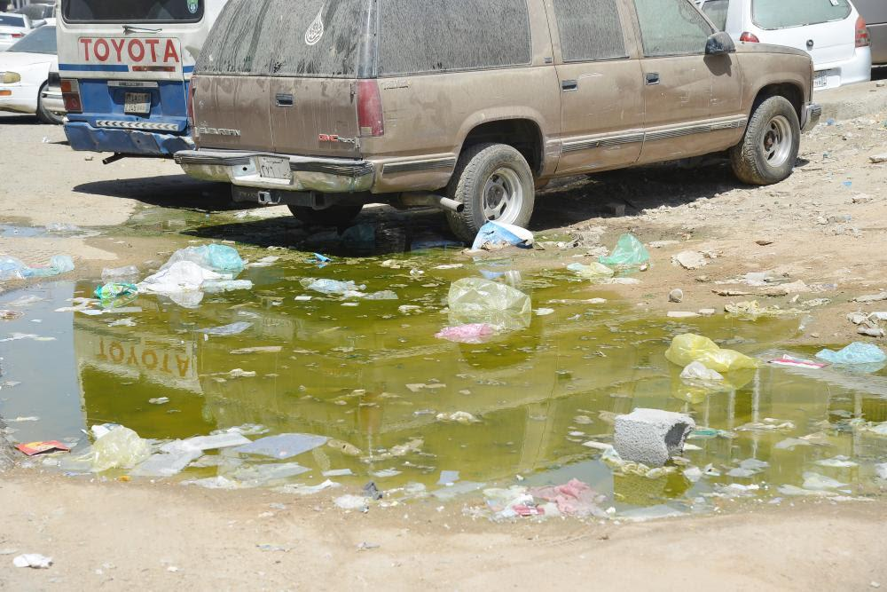 Most streets in Jeddah's Ghulail neighborhood are in a dilapidated condition while overflown sewage water is everywhere because of poor sewage network. — Okaz photo