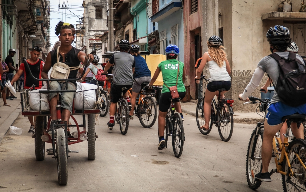 Tourists take a bicycle tour in Havana. A symbol of Cuba's economic crisis, bicycles are gradually coming back into fashion under the impulse of tourists and Cubans often discouraged by the country's poor public transportation system. - AFP