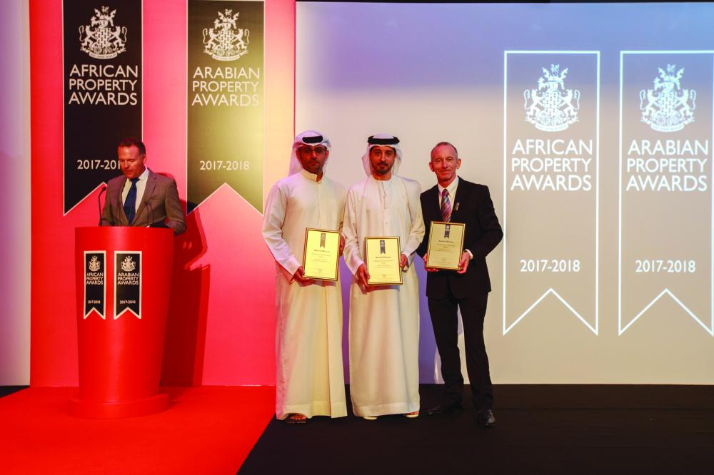Executives of Jumeirah Golf Estates show off the much-coveted awards