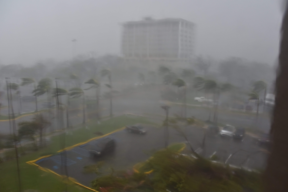 Rain and wind hit a parking lot at Roberto Clemente Coliseum in San Juan, Puerto Rico, on Wednesday. — AFP