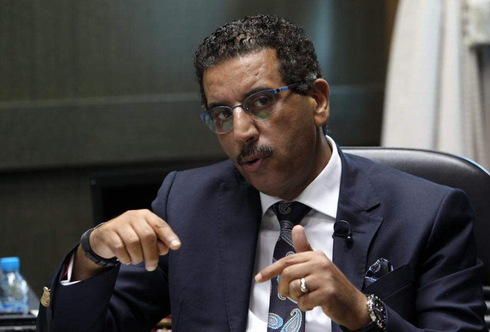 The director of the Central Bureau of Judicial Investigations, Abdelhak Khiame, gestures during an interview with The Associated Press at his headquarters in Sale near Rabat, Morocco. — AP