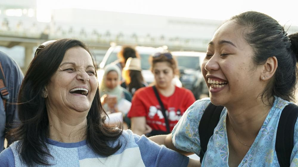 Rasmea Odeh (left) shares a laugh with supporter Monique Buni before boarding a flight to Amman Tuesday. Buni, 25, was one of dozens of demonstrators who gathered at Chicago's O'Hare International Airport to show their support for the Chicago Palestinian activist with a decades-old record of bombings in occupied Jerusalem prior to her deportation to Jordan. — AP