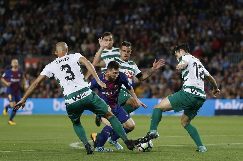 Barcelona's forward Lionel Messi (C) vies with Eibar players during the Spanish league football match at the Camp Nou Stadium in Barcelona Tuesday. — AFP