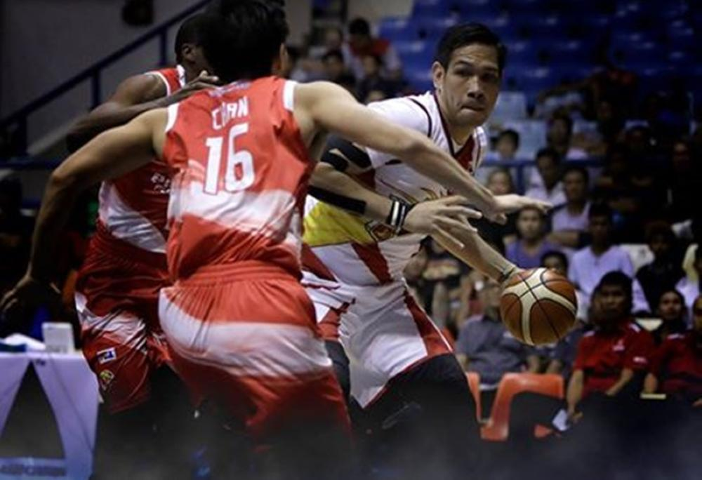 San Miguel Beer's June Mar Fajardo gets double-teamed by Phoenix's Jeff Chan and Brandon Brown Wednesday night's PBA Governors' Cup game at the Ynares Center in Antipolo City.