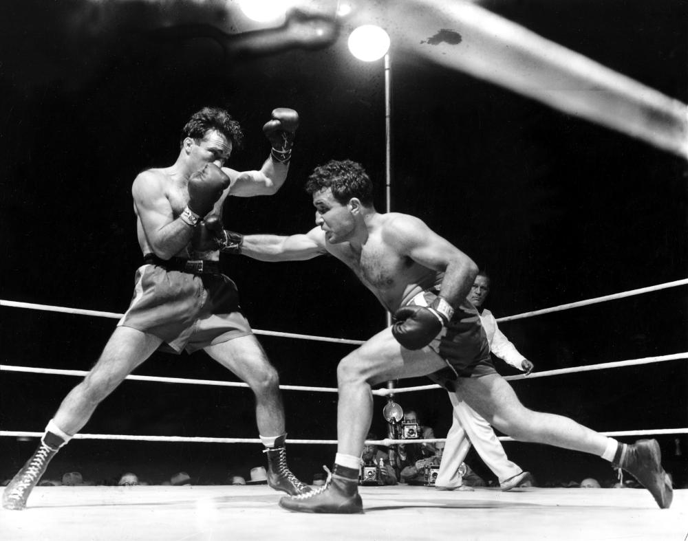 This June 16, 1949, file photo, shows Jake LaMotta (R) fighting Marcel Cerdan in Briggs Stadium in Detroit. LaMotta knocked out Cerdan in the tenth round to become the new world middleweight champion. — AP