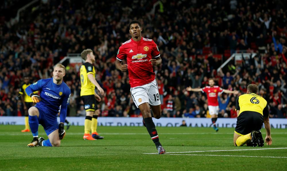Manchester United's Marcus Rashford celebrates scoring against Burton Albion during their League Cup match at Old Trafford Wednesday. — Reuters