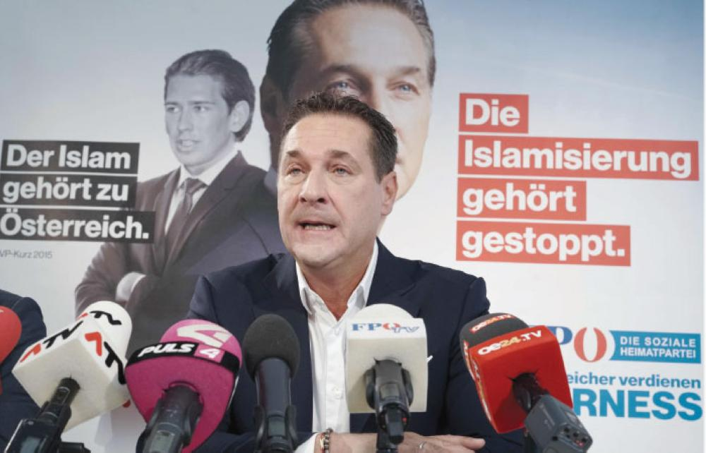"""Chairman of the Freedom Party of Austria (FPOe) Heinz-Christian Strache attends a press conference to present the party's new election posters reading """"Islamification should be stopped"""" (right) and """"The Islam belongs to Austria"""" (left) featuring Strache and Austrian Foreign minister Sebastian Kurz at FPOe headquarters in Vienna, ahead of Austrian parliamentary elections on Oct. 15. — AFP"""