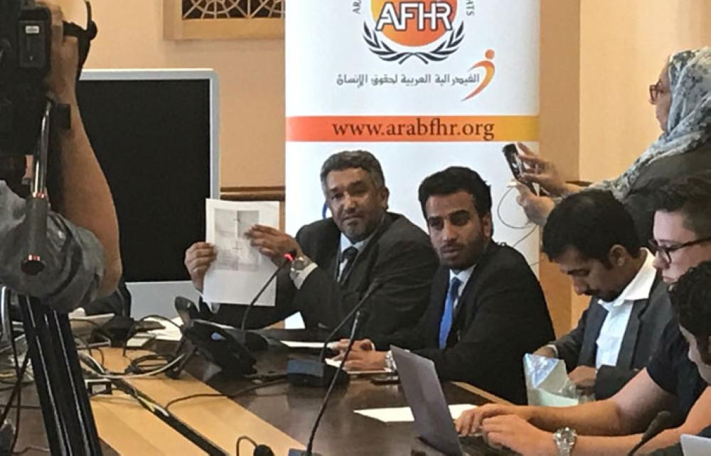Dr. Ahmed Al-Hamli, chairman of the Arab Federation for Human Rights shows the complaint.