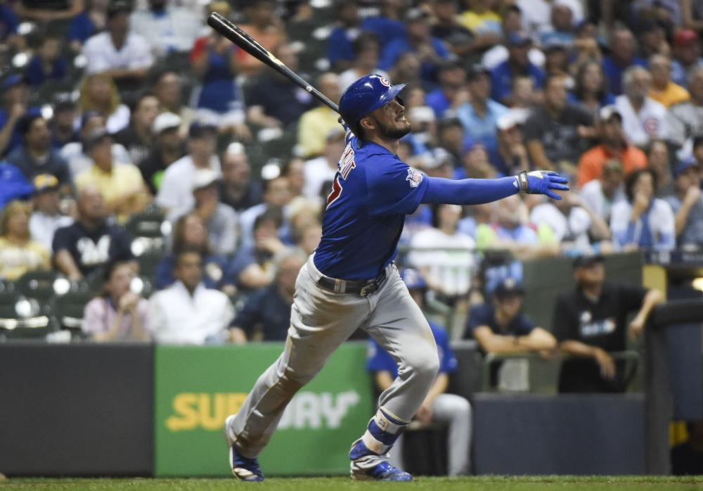 Chicago Cubs' third baseman Kris Bryant hits a 2-run homer in the tenth inning during the game against the Milwaukee Brewers at Miller Park in Milwaukee Thursday. — Reuters