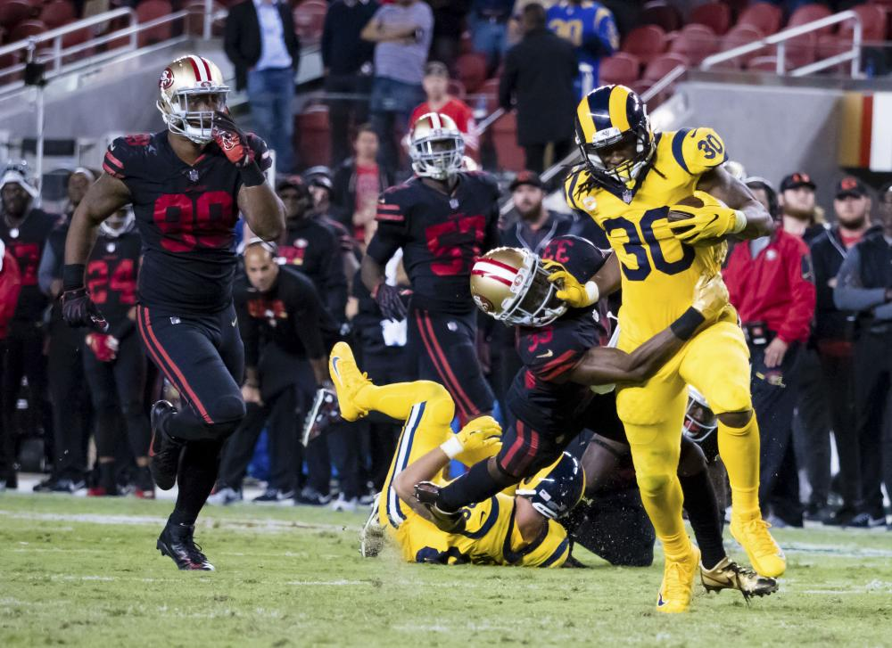 Los Angeles Rams' running back Todd Gurley carries the ball against San Francisco 49ers' cornerback Rashard Robinson during their NFL game at Levi's Stadium in Santa Clara Thursday. — Reuters