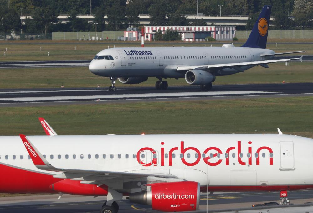 A Lufthansa airliner taxis next to the Air Berlin aircraft at Tegel airport in Berlin, Germany, in this file photo. — Reuters