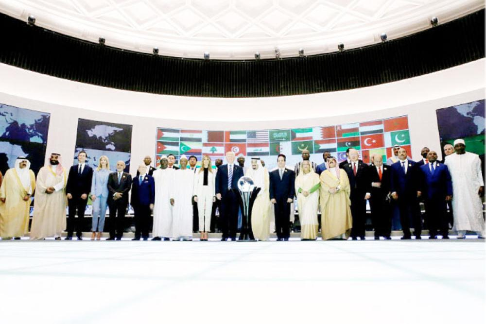 Custodian of the Two Holy Mosques King Salman, US President Donald Trump and leaders of Muslim countries stand for a family photo at the Global Center for Combatting Extremist Ideology in Riyadh on Sunday. — Reuters