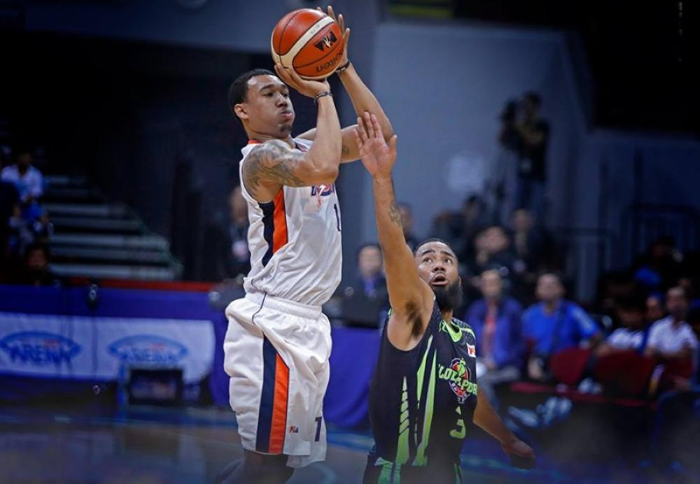 Meralco's Chris Newsome fires a shot off GlobalPort's Stanley Pringle in Friday night's PBA Governors' Cup at the Mall of Asia Arena.