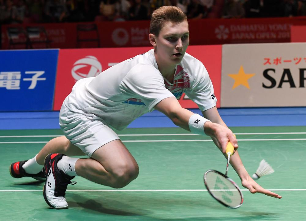 Viktor Axelsen of Denmark hits a return against Son Wan-ho of South Korea during their men's singles semifinal match at the Japan Open Badminton Championships in Tokyo Saturday. — AFP