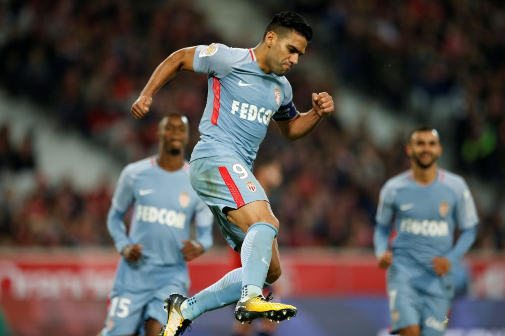 Monaco's Radamel Falcao celebrates scoring their fourth goal against Lille during their French league football match in Lille Friday. — Reuters
