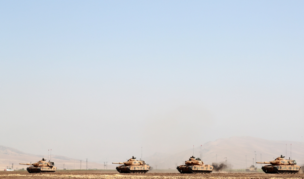 Turkish tanks maneuver during a military exercise near the Turkish-Iraqi border in Silopi, Turkey, on Saturday. — Reuters
