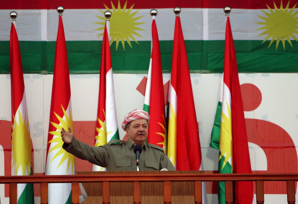 Iraqi Kurdish president Massoud Barzani salutes the crowd while attending a rally in Irbil. — Reuters