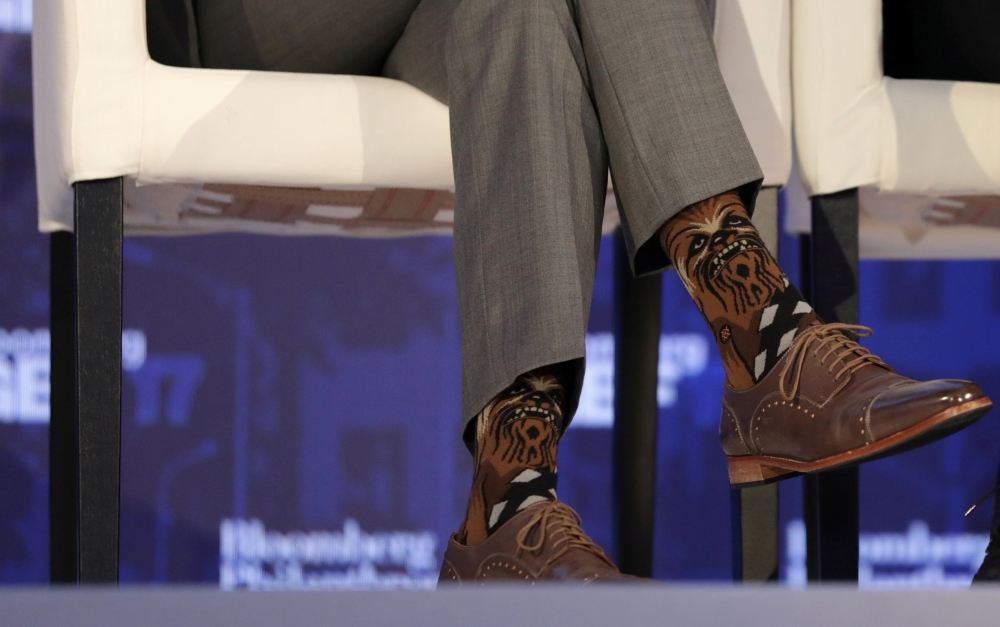 Canadian Prime Minister Justin Trudeau wears Chewbacca socks while participating in a panel discussion at a Bloomberg Global Business Forum panel event in New York City on Sept. 20. - Reuters