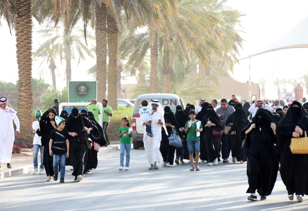 Saudi families arrive outside a stadium to attend National Day celebrations in Riyadh on Saturday. — AFP
