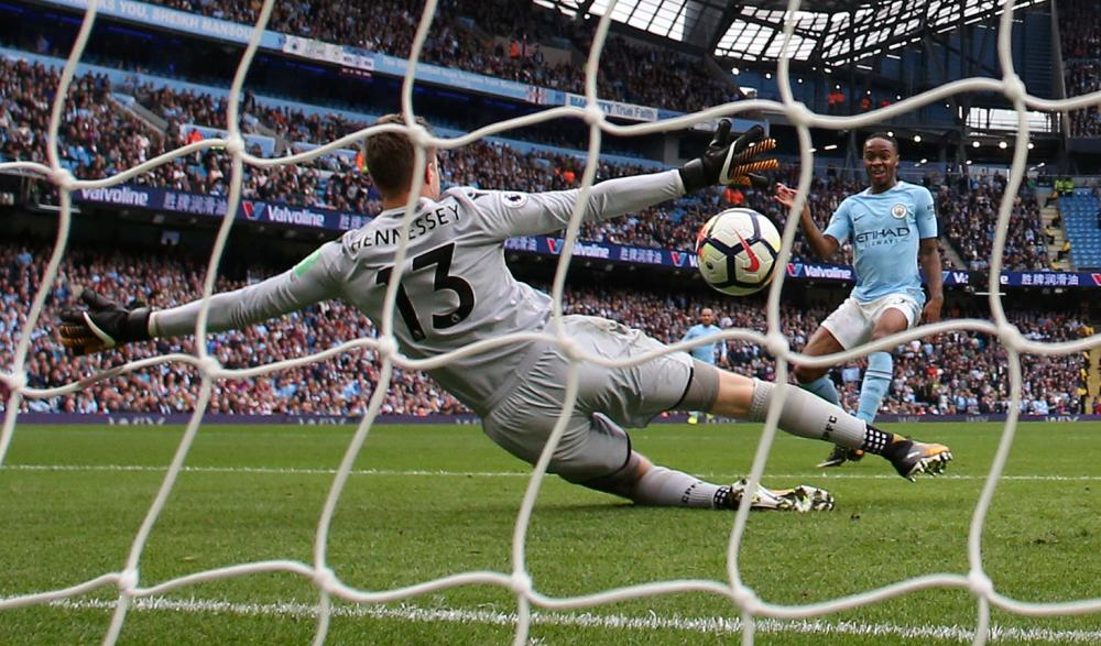 Manchester City's Raheem Sterling scores their second goal against Crystal Palace during their English Premier League match at the Etihad Stadium in Manchester Saturday. — Reuters