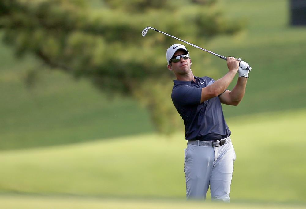 Paul Casey hits his approach shot on the 17th fairway during the third round of the Tour Championship Golf Tournament at East Lake Golf Club in Atlanta Saturday. — Reuters