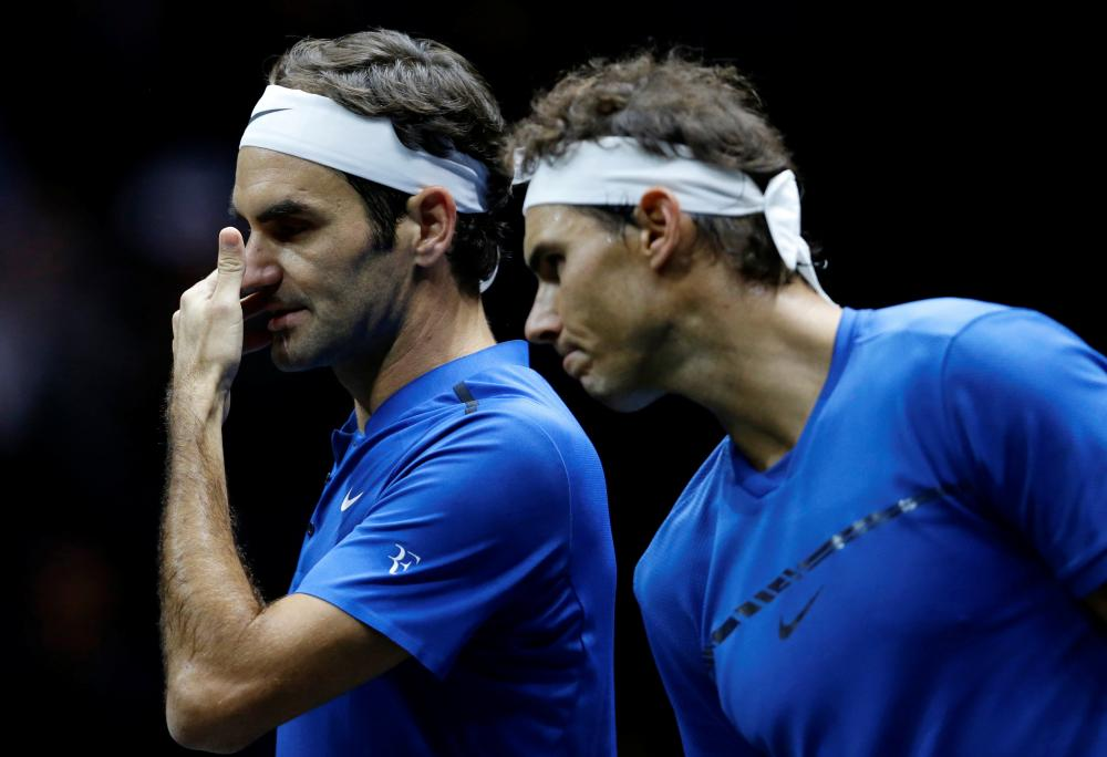 Roger Federer (L) and Rafael Nadal of team Europe in action against Jack Sock and Sam Querrey of team World in Prague Saturday. — Reuters