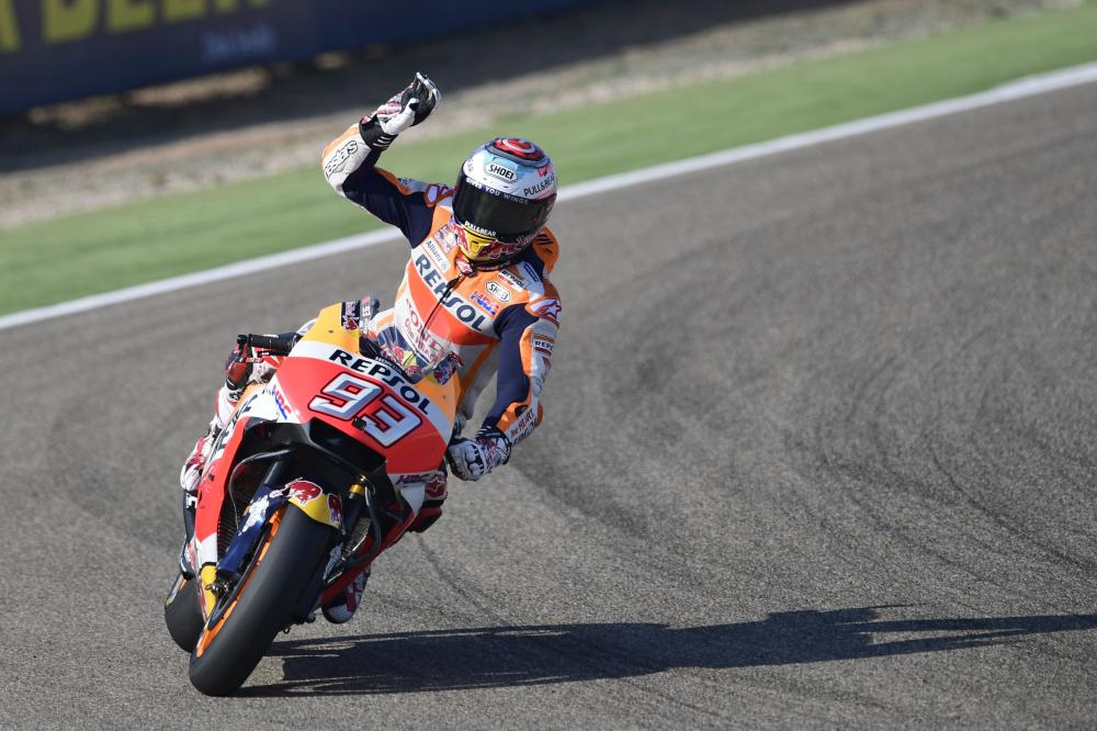 Repsol Honda Team's Spanish rider Marc Marquez greets from his bike after winning the Moto Grand Prix of Aragon at the Motorland circuit in Alcaniz in Spain Sunday. — AFP