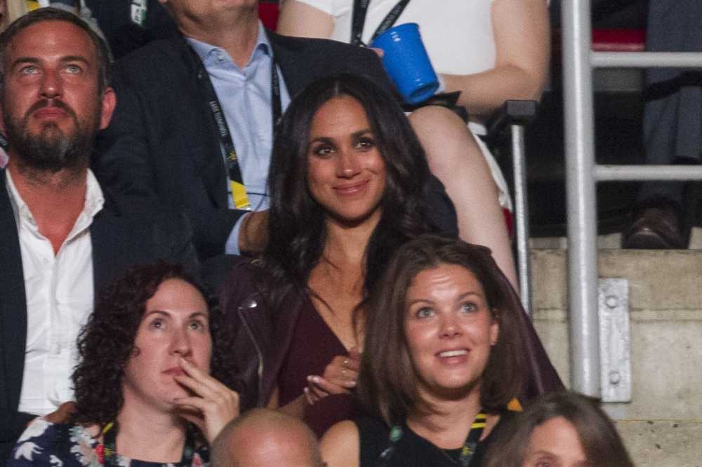 Actress Meghan Markle watches the opening ceremonies of the Invictus Games in Toronto, Ontario on Sunday. - AFP