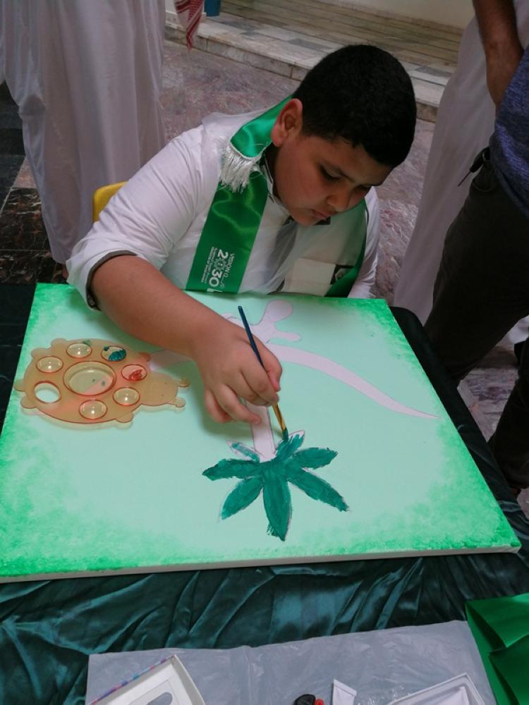 A Saudi student participates in a competition to mark the Saudi 87th National Day on Friday night.