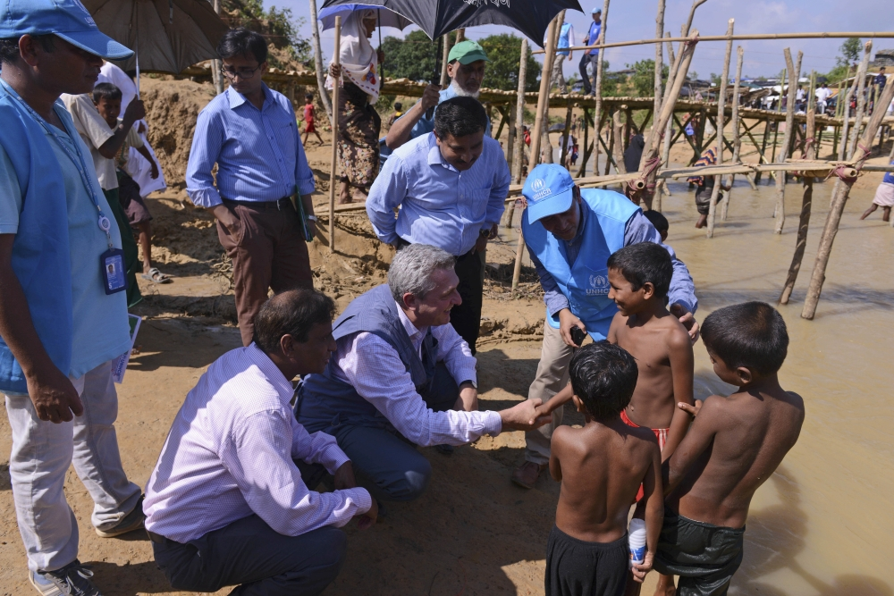 United Nations High Commissioner for Refugees Filippo Grandi, center, interacts with Rohingya Muslim children at Kutupalong, Cox's Bazar, Bangladesh. — AP