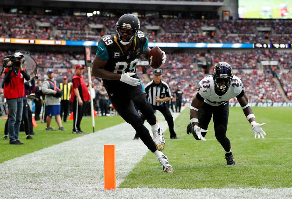 Marcedes Lewis of the Jacksonville Jaguars scores a touchdown against Baltimore Ravens in the NFL International Series at the Wembley Stadium in London Sunday. — Reuters