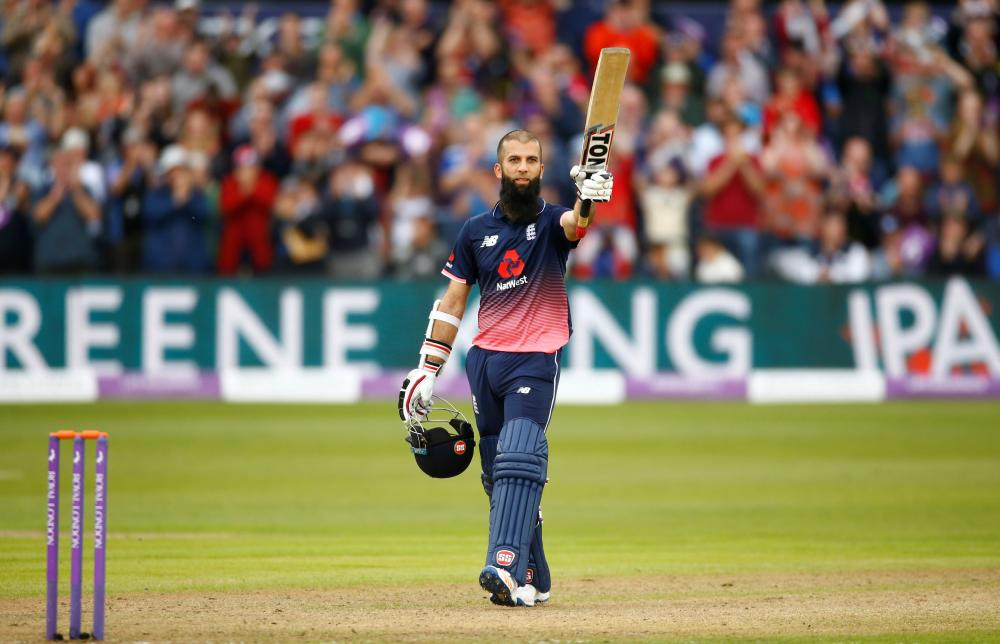 England's Moeen Ali celebrates his century against West Indies during their third One-Day International match in Bristol Sunday. — Reuters