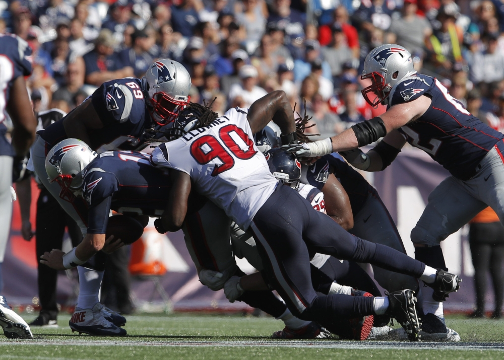 Houston Texans outside linebacker Jadeveon Clowney (90) sacks New England Patriots quarterback Tom Brady (12) in the second half at Gillette Stadium in Foxborough, MA, on Sunday. — Reuters