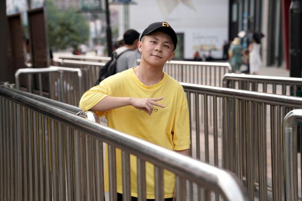 Li Yijie, a member of the Sichuan-based rap band Tianfu Shibian, poses for a photo in Beijing, China. - Reuters