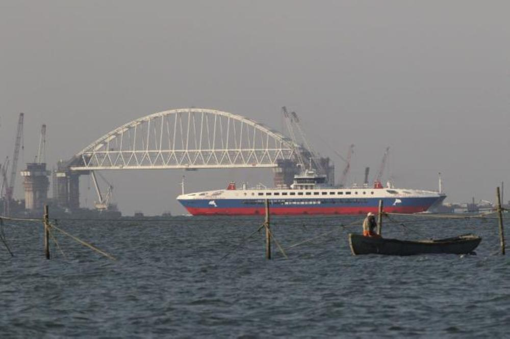 A Pobeda ferry sails past a railroad arch of a road-and-rail bridge, which is constructed to connect the Russian mainland with the Crimean peninsula, in the Kerch Strait, Crimea, in this Sept. 22, 2017 file photo. — Reuters