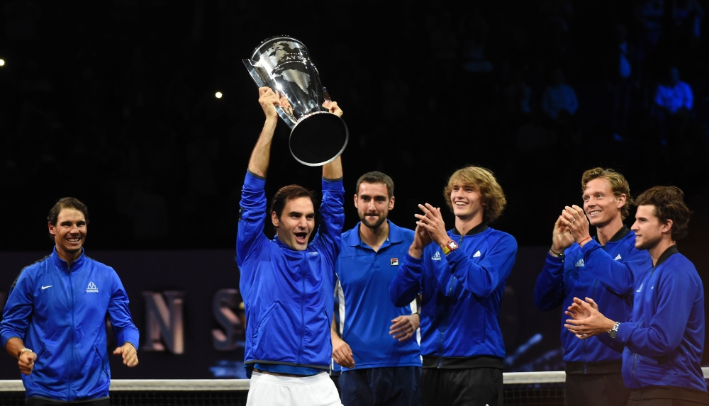 Roger Federer of Team Europe and his teammates celebrate with the Laver Cup trophy on Sunday in O2 Arena, in Prague.  — AFP