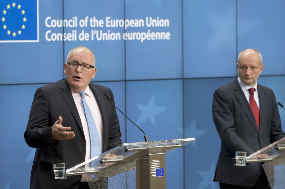 European Commission Vice President Frans Timmermans, left, speaks during a media conference after a meeting of EU General Affairs ministers at the Europa building in Brussels on Monday. — AP