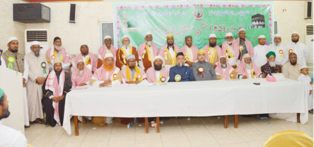 Guests pilgrams with Moulana Afroz Naveed Afrooz president Jamia Nizamia (sitting 6th from right) at annual function to 'welcome pilgrims'. — Courtesy photo