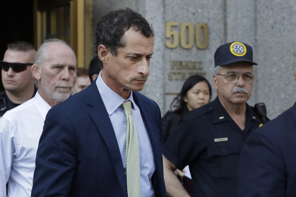 Former Congressman Anthony Weiner leaves federal court following his sentencing in New York on Monday. — AP