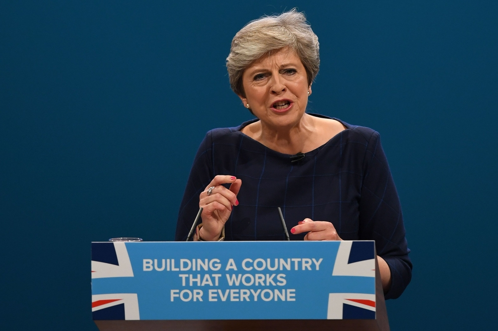 Britain's Prime Minister Theresa May delivers her speech on the final day of the Conservative Party annual conference at the Manchester Central Convention Centre in Manchester, northwest England, on Wednesday. — AFP